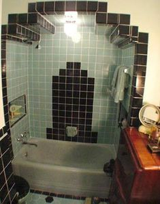 Art Deco style 1930s bathroom.  A little too much for my modest 1940s tastes, but still really cool looking.