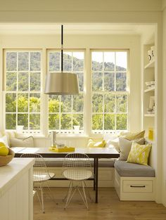 Right idea for breakfast nook minus the fluffy pillows and wire chairs.