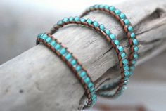 Triple wrap leather bracelet with 4mm translucent glass beads with seafoam center and solid silver plated button