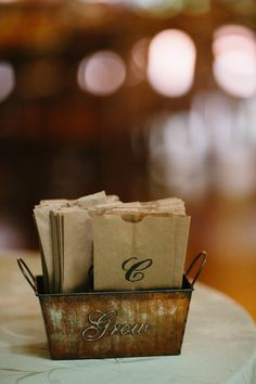 paper bags with stamped initial for candy bar wedding favors #weddingfavors #candybar #weddingchicks http://www.weddingchicks.com/2014/01/30/time-travel-wedding/