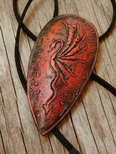 Red Dragon Shield necklace by TreeWingsStudio on Etsy, $22.00