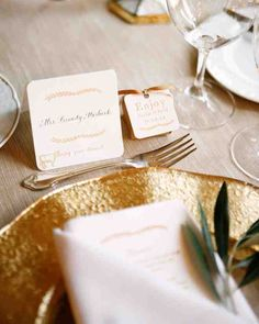 Letterpressed cards were calligraphed with each guest's name and rubber stamped to indicate their choice of dinner entrée. Menus were tucked into folded napkins alongside of a sprig of olive branch. Chocolate truffles wrapped in gold foil and packaged in simple kraft paper candy boxes were finished with custom tags from Austin Press.