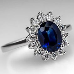 This estate piece from EraGem has a natural blue sapphire set in platinum. #engagementring #diamondring #custommade