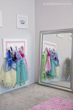 …Or display colorful costumes as art. | 49 Clever Storage Solutions For Living With Kids