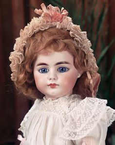 "*BEAUTIFUL GERMAN BISQUE CHILD, 719 ~ by: Simon & Halbig, 20"" T.  Bisque socket head w/flattened solid dome, blue glass inset eyes.... MARKS: S 12 H 719 dep.  COMMENTS: Simon & Halbig, c.1890.....Theriault's Antique Doll Auctions"