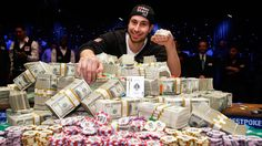 Jonathan Duhamel poses for photos after winning the World Series of Poker on Monday in Las Vegas.