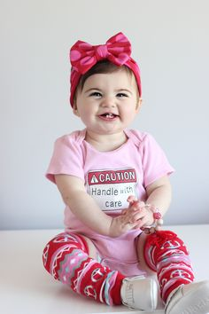 """There are no words that can fully describe the abundance of cuteness in this photo ❤️❤️ Love this little lady @cadynanddylan Rockin' her """"Handle with Care"""" onesie this Monday morning"""
