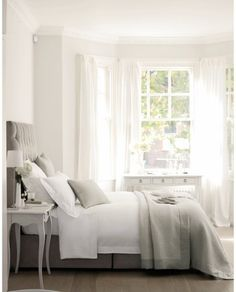 gray and white bedroom - love the wall color with the white, sheer curtains.