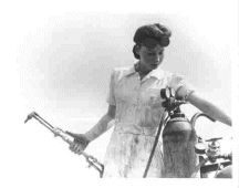 Favorite woman welding picture I have come across. I want that dress. I wonder if Carhart makes one?