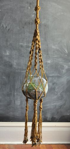 Vintage Macrame Large Hanging Planter Basket. $65.00, via Etsy.