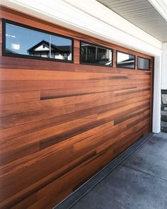 Yep, you read that right - this FAUX wood Planks garage door is actually made of steel. We're lovin' how the black window trim looks with Cedar 🖤 Pick out your free color samples, build a door on DoorVisions, request a quote, + more. // shown: Planks in Cedar with optional black window trim. via @diesel_ohd on IG Faux Wood Garage Door, Garage Door Windows, Modern Garage Doors, Windows And Doors, Black Window Trims, Black Windows, Building A Door, Types Of Insulation, Window Types