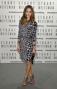 We're always a fan of an animal print — especially when it's accessorized with metallics, as Olivia did at the opening of the Zaha Hadid-designed Stuart Weitzman store in Milan.