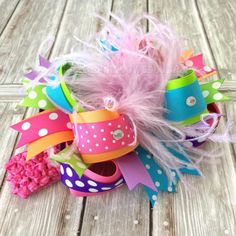 Our Trendy #Rainbow Sherbet Over the Top Hair Bow or Baby Headband comes attached to your choice of alligator clip, French barrette, or as a bow and headband set. - made wit... #new #girlshairbows #bighairbows #overthetopbows #tutudresses #babyrompers #easter #feathers #purple #rainbow #rhinestones ➡️…