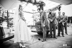 Bride watches as Groom steps on wine glass during wedding ceremony at museum #weddingphotography / just added