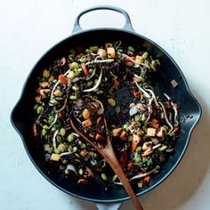 Pineapple Black Fried Rice | This Pineapple Black Fried Rice is a stunning twist on a classic, with edamame, bean sprouts, and juicy pineapple buried like jewels in the dark grains. Get the recipe at Food & Wine.
