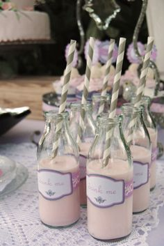 Sweet bottles and grey striped straws