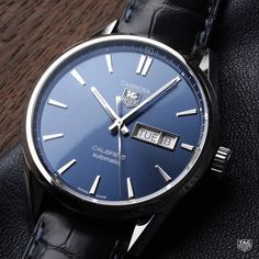 Blue - the colorof trust loyalty wisdom and the stunning dial on this TAG Heuer Carrera Calibre 5. #DontCrackUnderPressure #TAGHeuer #Calibre5 #DayDate #Tagheuercarrera #Watch #MenStyle #Reloj #swissmade by tagheuer
