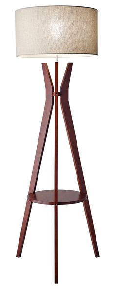 Sleek and stylish, this Chaddington Floor Lamp will do far more than just illuminate your home. Made with a chic, solid walnut wood tripod frame and topped with an oatmeal linen shade, this light boast...  Find the Chaddington Floor Lamp, as seen in the We Love 1950s Style Collection at http://dotandbo.com/collections/we-love-1950s-style?utm_source=pinterest&utm_medium=organic&db_sku=115796