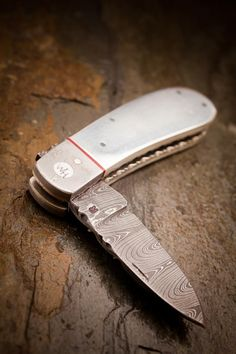 The Wyatt silver pocket knife - solid silver handle and Damascus blade (from He Man Tools and Bourbon & Boots)