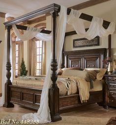 Dark brown teak canopy bed frame decor with height headboard and white sheer curtain. Incredible Four Poster Bed Frame Design Ideas & Bedroom Photos Canopy Bed Design Pictures Remodel Decor and ...