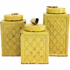 """Showcasing a scrolling lattice motif and distressed yellow finish, these ceramic canisters are perfect for organizing your kitchen essentials or as catch-alls around the house.    Product: Small, medium and large canisterConstruction Material: MetalColor: Distressed yellowFeatures:  Adds country-chic charm to any roomArtfully crafted Dimensions: 11"""" H x 5.5"""" W x 3"""" D (large)"""