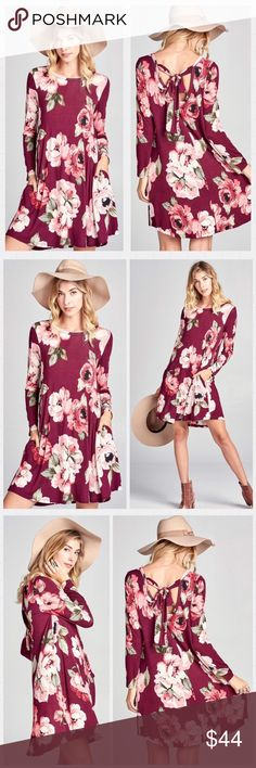 😍Stunning😍 Wine floral print swing dress. S-M-L Stunning Floral print jersey knit swing dress with long sleeves and side pockets. It's scooped back is finished with long bow-tied ribbons.  Made in USA 🇺🇸  Available in S-M-L Dresses Midi