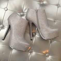 "NWOB Silver platform stiletto booties Gorgeous metallic silver ankle booties with chain detail near sole. Approx 5 3/4"". Never worn. Shoes Platforms"