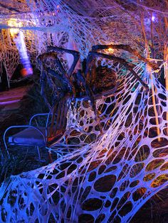 Mitchell's Halloween 2013... side view of one of our hand-made spiders. It is about 5 foot wide! LOVE using the beef-netting spider's web!