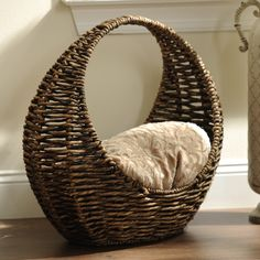 Keep your home organized with this Woven Crescent Basket from Kirkland's! It's perfect for storing blankets, magazines or anything else!