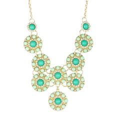 """Antique gold plated green resin stone and pave glass crystal disc bib necklace. Lobster clasp Approx. 18"""" chain length with 2.5"""" extension Approx. 4"""" L x 4.5"""" W bib Imported  Crafty Online - Green Circle Medallion Necklace, $62.00 (http://www.craftyonline.net/green-circle-medallion-necklace/)"""
