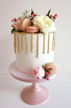 gold, white, and baby pink drip wedding cake with macaroons. Heaven!
