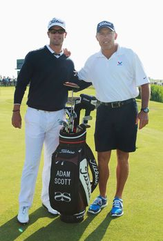 Adam Scott of Australia poses with caddy Steve Williams during the second round of The 140th Open Championship at Royal St George's on July 15, 2011 in Sandwich, England.