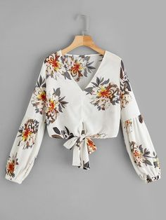 Casual Knot Floral Top Regular Fit V Neck Long Sleeve Bishop Sleeve Pullovers Beige Crop Length Floral Print Knot Hem Blouse See other ideas and pictures from the category menu…. Faneks healthy and active life ideas Hijab Fashion, Teen Fashion, Fashion Dresses, Spring Shirts, Summer Blouses, Blouse Styles, Blouse Designs, Moda Rock, Girl Outfits