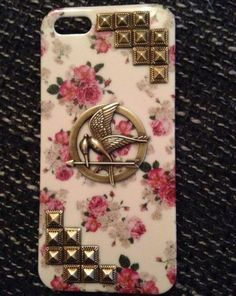 Best of all worlds...floral, hunger games and studs!!!
