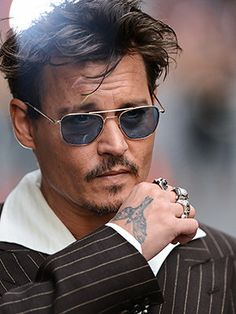 0d33b15808c Behind the Ink  Johnny Depp s Crow Tattoo (and Other Body Art) Explained