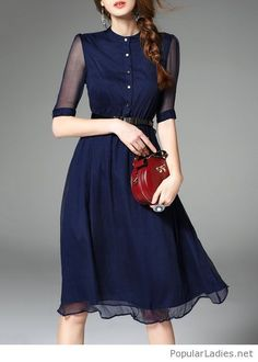 Navy dress and red bag