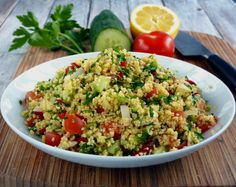 This fresh and healthy Levatine vegetarian salad is made with bulgur and other herbs but couscous can also be a substitute.| www.foxyfolksy.com