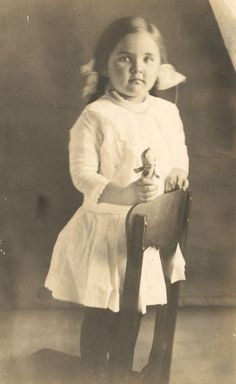vintage photograph of a child holding a kewpie doll #vintagedolls