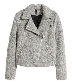 Biker jacket in wool-blend bouclé. Diagonal zip at front, snap fasteners on lapels, and side pockets with zip. Lined.