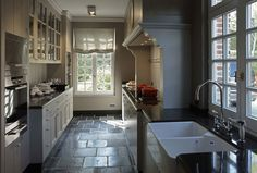 Love the woodwork around 'inset' for stove; all the white w/dark flooring.