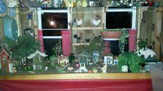 My fairy garden ~ across the end of our porch