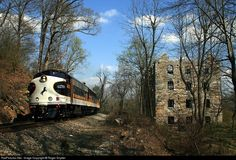"""""""AFTERNOON DELIGHT"""" chased but never subdued, slips past the ruins of Chapman's Mill in Thoroughfare Gap, VA, about mp 14 on the NS B-Line at on The mill was built in 1742 and the Manassas Gap Railroad was finished in B Line, Railroad History, Southern Railways, Afternoon Delight, Norfolk Southern, Photo Search, Stone Houses, Locomotive"""