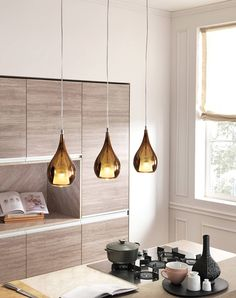 These hanging lamps are super cool, and reflect the tones in the cupboard doors. Cangini e Tucci - ZOE : Lighting by Cangini e Tucci