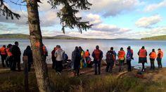 Miekojärvi lake and travellers admiring net fishing