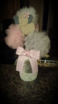 My baby shower decorations for maritzas baby girl elephant theme center pieces! Mason jars!