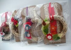 Cute as package/ present adournments or as ornaments! Mini wreath made of curtain rings