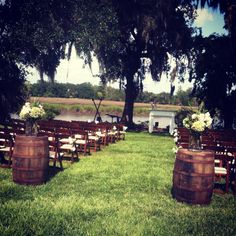 Wine barrels at the beginning of aisle ... we can push them together a first so people dont walk down the aisle before you do