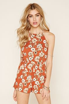 A woven romper with a self-tie halter neckline, an allover floral print, and a partially elasticized waist.