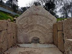 The Pedra Famosa, a part of a pre Roman  Celtic Sauna in Citania de Briteiros. showing the carved Triskels.