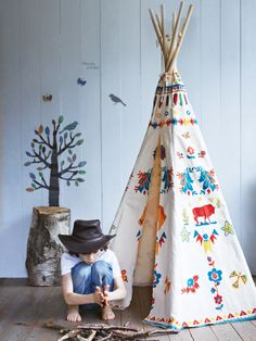 Indian Teepee - With a stunning textile print, this wood and denim canvas teepee or wigwam is ideal for both indoors and out, and for both squaws and braves. £115.00